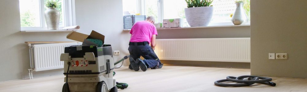 Recoating of a wood floor or parquet in Amsterdam. Wood floor sanding in Amsterdam